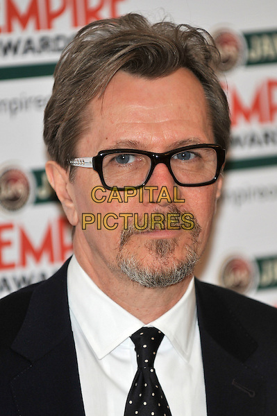 Gary Oldman.The Jameson Empire Awards 2012 at the Grosvenor House Hotel, London, England 25th May 2012.headshot portrait black white glasses goatee facial hair .CAP/PL.©Phil Loftus/Capital Pictures.