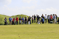 Spectators at the 8th green during Round 1 of the Irish Amateur Close Championship at Seapoint Golf Club on Saturday 7th June 2014.<br /> Picture:  Thos Caffrey / www.golffile.ie