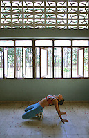 01 FEB 2003 - SANTA CLARA, CUBA - Anmary Lopez Cabrera stretches after a workout. (PHOTO (C) NIGEL FARROW)