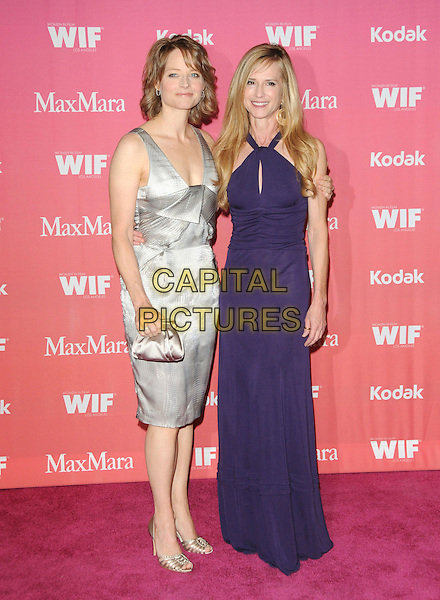 JODIE FOSTER & HOLLY HUNTER .at The Women in Film 2009 Crystal .and Lucy Awards held at The Hyatt Regency Century Plaza in Century City, California, USA, June 12th 2009                                                                     .full length dress long maxi purple cut out halterneck  grey gray silver clutch bag shoes gold .CAP/DVS.©DVS/RockinExposures/Capital Pictures