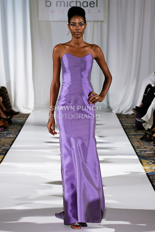 Gate walks runway in a monet blue, silk-faced wool corset gown, from the b Michael AMERICA Couture Spring 2013 collection during Mercedes-Benz Fashion Week Spring 2013, at the Jumeirah Essex House on September 12, 2012.