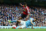 Gael Clichy of Manchester City tackles Marcus Rashford of Manchester United during the Barclays Premier League match at Old Trafford. Photo credit should read: Philip Oldham/Sportimage