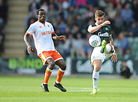 Plymouth Argyle's Graham Carey under pressure from Blackpool's Marc Bola<br /> <br /> Photographer Kevin Barnes/CameraSport<br /> <br /> The EFL Sky Bet League One - Plymouth Argyle v Blackpool - Saturday 15th September 2018 - Home Park - Plymouth<br /> <br /> World Copyright &copy; 2018 CameraSport. All rights reserved. 43 Linden Ave. Countesthorpe. Leicester. England. LE8 5PG - Tel: +44 (0) 116 277 4147 - admin@camerasport.com - www.camerasport.com