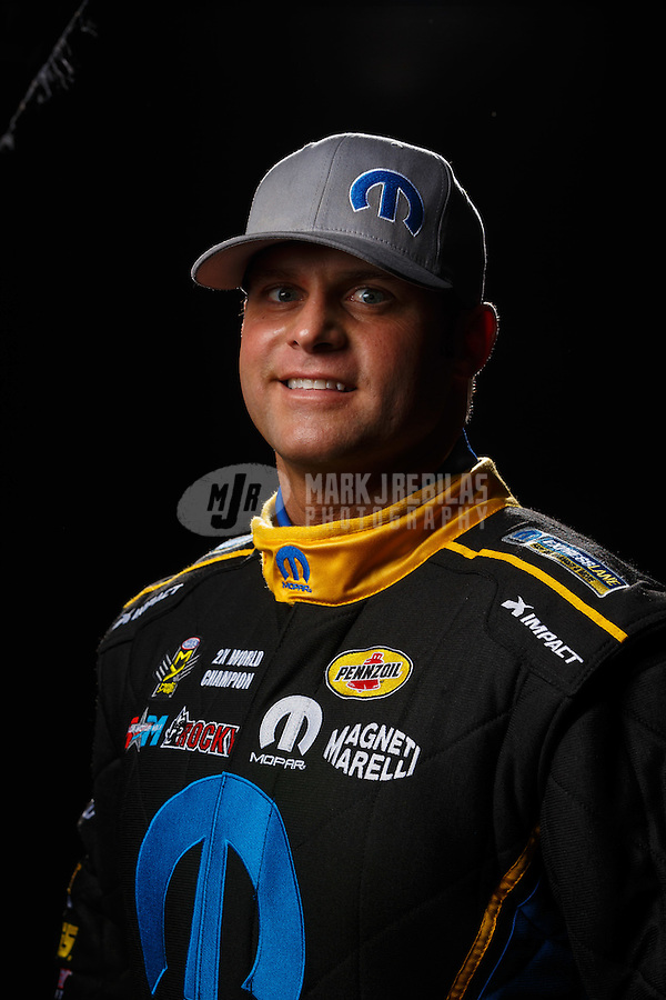 Feb 10, 2016; Pomona, CA, USA; NHRA funny car driver Matt Hagan poses for a portrait during media day at Auto Club Raceway at Pomona. Mandatory Credit: Mark J. Rebilas-USA TODAY Sports