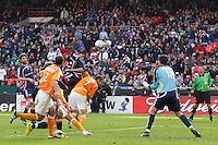Houston Dynamo goalkeeper (18) Pat Onstad makes a save on a header by New England Revolution midfielder (21) Shalrie Joseph. The Houston Dynamo defeated the New England Revolution 2-1 in the finals of the MLS Cup at RFK Memorial Stadium in Washington, D. C., on November 18, 2007.