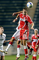 Chicago Fire defender Gonzalo Segares (25) and New England Revolution midfielder Jose Cancela (7) battle for a header.  The Chicago Fire defeated the New England Revolution 2-1 in the quarterfinals of the U.S. Open Cup at Toyota Park in Bridgeview, IL on August 23, 2006...