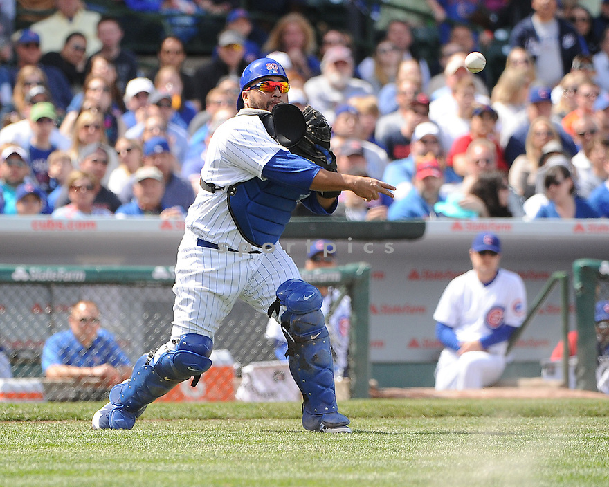 Chicago Cubs Dioner Navarro (30) during a game against the Cincinnati Reds on May 5, 2013 at Wrigley Field in Chicago, IL. The Reds beat the Cubs 7-4.