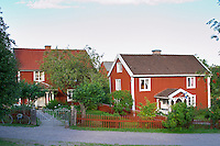 The red houses on the road in Bullerbyn Mellangården, The Middle House. Sörgården, The South House. The original location where Astrid Lindgren's story on Bullerbyn was filmed. In reality called Sevedstorp. Smaland region. Sweden, Europe.