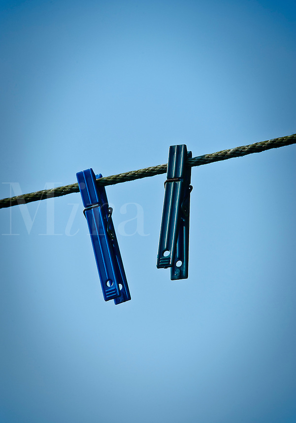 Two clothes pins on a line.