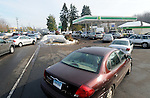 Cars wait in line at a BP gas station on Route 30  in Manchester, waiting for a gasoline tanker delivery, Monday, Oct. 31, 2011, some waiting for three hours. This was only one a few stations opened in the area.  (Jim Michaud/Journal Inquirer)