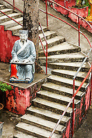 Statue of a sitting man along trail to Ten Thousand Buddhas, Sha Tin, New Territories, Hong Kong SAR, People's Repbulic of China, Asia