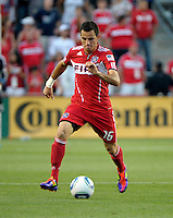 Chicago midfielder Marco Pappa (16) dribbles the ball.  The Portland Timbers defeated the Chicago Fire 1-0 at Toyota Park in Bridgeview, IL on July 16, 2011.