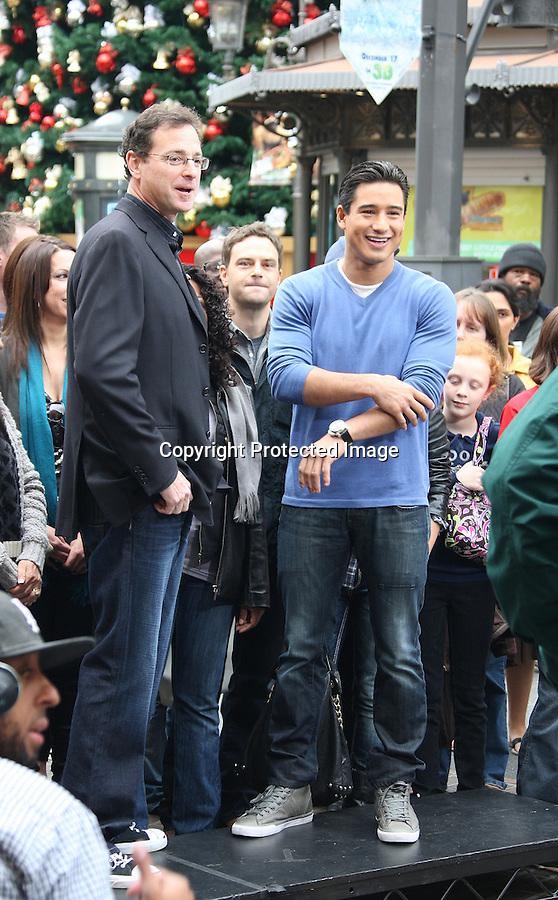 November 19th 2010 ..Mario Lopez filming the television show Extra with Bob Saget at the Grove shopping center in Los Angeles ..AbilityFilms@yahoo.com.805-427-3519.www.AbilityFilms.com.