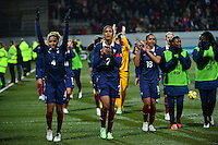 Lorient, France. - Sunday, February 8, 2015:  Laura Georges (4), Wendie Renard (2), and Marie-Laure Delie (18) of France celebrate with fans after the match. France defeated the USWNT 2-0 during an international friendly at the Stade du Moustoir.