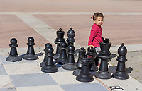 Toddler, child, girl, female, open-air, chessboard, chess board, promenade, Estepona, Malaga, Spain, February, 2019, 201902018390<br />