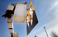 NWA Democrat-Gazette/DAVID GOTTSCHALK  Eddie Chale, with Mayan Signs of Springdale, lifts up Tuesday, January 8, 2019, a new sign for installation at Lewis & Clark Outfitters in Springdale. The signage on the building are being converted from florescent bulbs to light emitting diodes and the facades of the signs are being replaced with a Lexan translucent plastic.