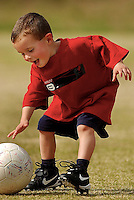 A young boy learns how to play soccer on a youth soccer league in Charlotte, NC