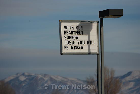 Trent Nelson  |  The Salt Lake Tribune.gas station sign put up by friends of slain Millard County Sheriff Deputy Josie Fox, pay their respects at the seen of the shooting Tuesday, January 5, 2010.