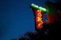 Joe's stone crabs neon sign illuminating another evening in miami beach