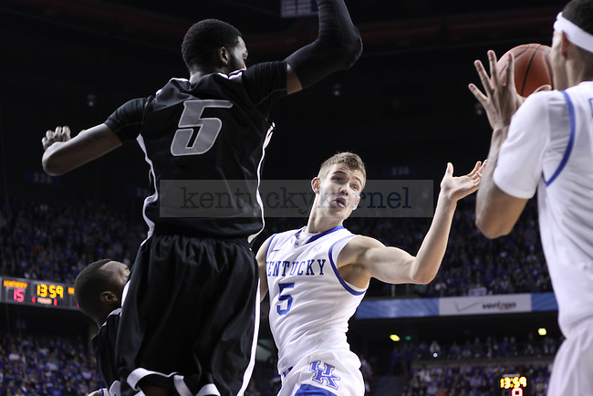 UK junior guard Jarrod Polson passes the ball off against LIU at Rupp Arena on Friday, Nov. 23, 2012. Photo by Scott Hannigan | Staff