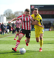 Lincoln City's Shay McCartan battles with Cheltenham Town's Chris Hussey<br /> <br /> Photographer Andrew Vaughan/CameraSport<br /> <br /> The EFL Sky Bet League Two - Lincoln City v Cheltenham Town - Saturday 13th April 2019 - Sincil Bank - Lincoln<br /> <br /> World Copyright © 2019 CameraSport. All rights reserved. 43 Linden Ave. Countesthorpe. Leicester. England. LE8 5PG - Tel: +44 (0) 116 277 4147 - admin@camerasport.com - www.camerasport.com