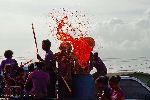 Red dye being squited from a truck -Phagwa or Holi, Felicity