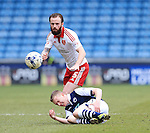 Millwall's Chris Taylor goes down under the challenge from Sheffield United's Chris Brayford during the League One match at The Den.  Photo credit should read: David Klein/Sportimage
