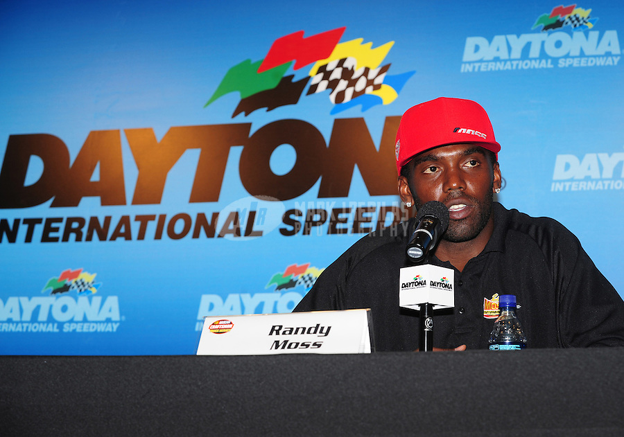 Jul. 3, 2008; Daytona Beach, FL, USA; New England Patriots wide receiver Randy Moss announces his co-ownership of a NASCAR Craftsman Truck Series team prior to practice for the Coke Zero 400 at Daytona International Speedway. Mandatory Credit: Mark J. Rebilas-