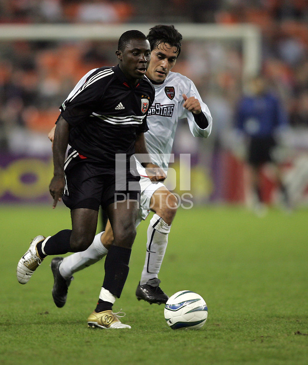 30 October,  2004.   DC United's Freddy Adu (9) sprints with the ball during the 2004 MLS playoffs at RFK Stadium in Washington, DC.