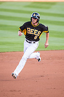 Josh Rutledge (8) of the Salt Lake Bees hustles towards third base against the Sacramento River Cats at Smith's Ballpark on April 20, 2015 in Ogden, Utah.  (Stephen Smith/Four Seam Images)