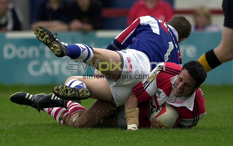 Pic by....Ben Duffy...Wakefield v Wigan..06/08/00..COPYRIGHT>>SIMON WILKINSON..Lee Gilmour goes over for the second Wigan try.