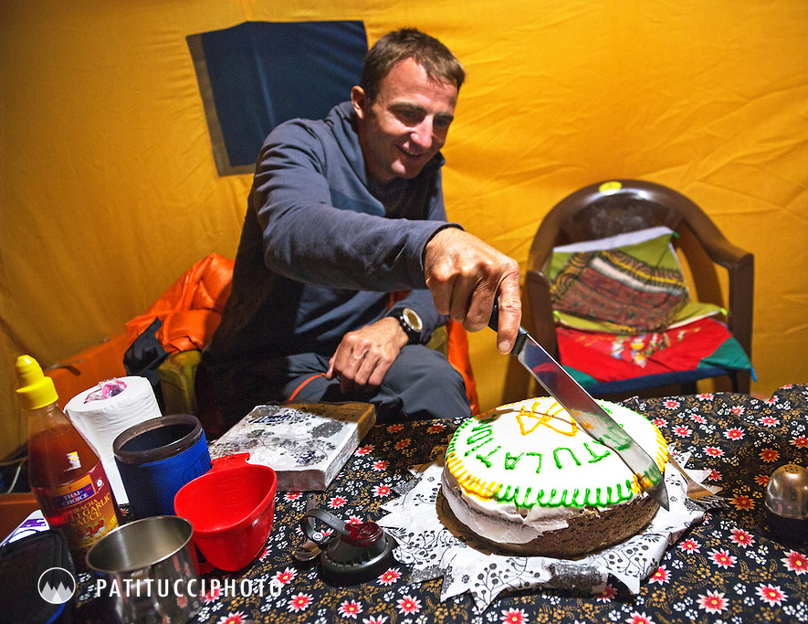 Ueli Steck returned to Nepal and the Annapurna south face in 2013 which he climbed solo, without oxygen, in one 28 hour alpine push, via a new route. The trip was his third attempt to climb the 8000 meter peak. Ueli celebrating his birthday and cutting his birthday cake in basecamp.