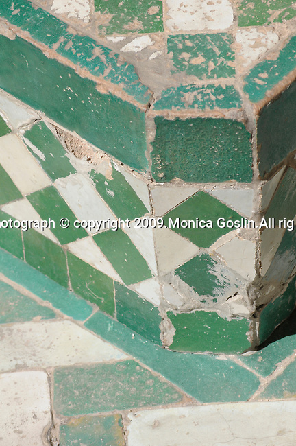 Green and white tiles in the Bahia Palace in Marrakesh, Morocco.