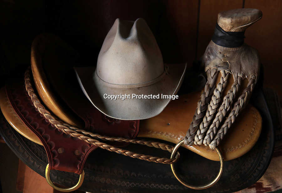 Sonny Keakealani, one of the most respected cowboys in the community and patriarch of the Keakealani family, has one of his many saddles and hats sitting in the corner of his living room. Keakealani's saddle is the traditional Hawaiian tree saddle unique to the Hawaiian islands.  The Hawaiian tree saddle has a rawhide fork cover with integral braids, attaching it to the rigging ring. This allows the saddle to be stripped down to the bare tree, making it waterproof for swimming cattle to the boats.