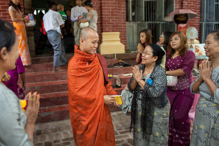Monk Wirathu is welcomed by supporters at this pagoda in Mandalay. Since publicly promoting the 969 movement on social networks, Wirathu has been labeled as the Buddhist Bin Laden. 08 June 2013 © Nicolas Axelrod / Ruom