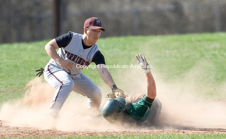 WATERBURY, CT- 21 APRIL 2008- 042108JT09-<br /> Holy Cross' Kyle Murphy is out at third by Torrington's Miguel Gonzalez during Monday's game at Holy Cross. Holy Cross won 21-6.<br /> Josalee Thrift / Republican-American