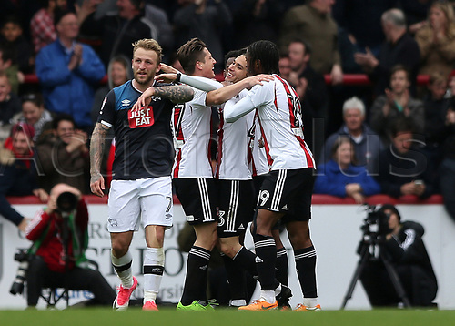 April 14th 2017,  Brent, London, England; Skybet Championship football, Brentford versus Derby County; Jota of Brentford celebrates scoring his sides 2nd goal in the 70th minute to make it 2-0 with Konstantin Kerschbaumer of Brentford and Romaine Sawyers of Brentford