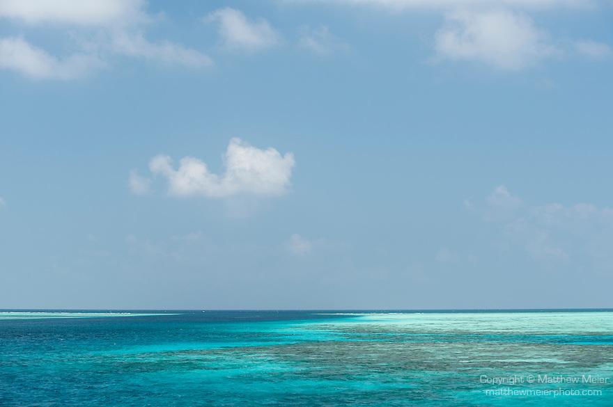 Mulak Kandu, Mulaku Atoll, Maldives; a view of the shallow coral reef and tropical blue water near the deep water pass between two islands