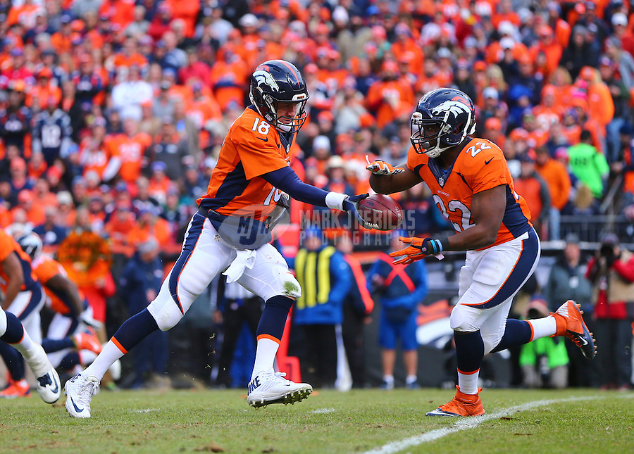 Jan 24, 2016; Denver, CO, USA; Denver Broncos quarterback Peyton Manning (18) hands off the ball to running back C.J. Anderson (22) against the New England Patriots in the AFC Championship football game at Sports Authority Field at Mile High. The Broncos defeated the Patriots 20-18 to advance to the Super Bowl. Mandatory Credit: Mark J. Rebilas-USA TODAY Sports
