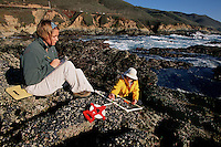 The area exposed at low tide and underwater at high tide is the intertidal zone . Scientists study the rocky intertidal to document changes over time, Soberanes Point, California, Pacific Ocean