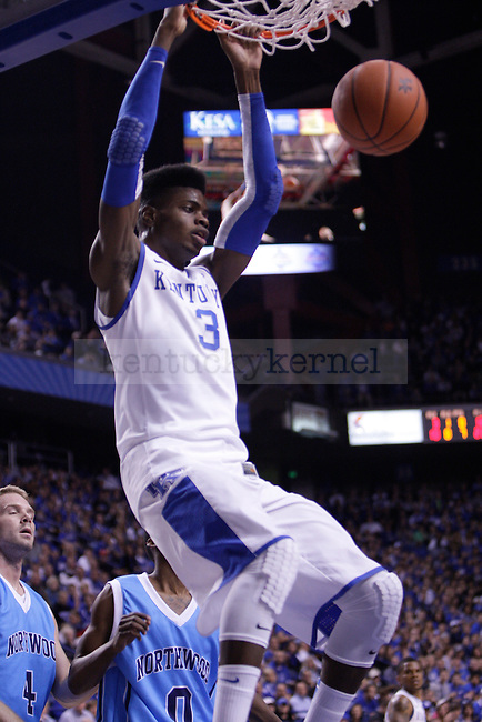Freshman Center Nerlens Noel slams in a dunk during the first half of the University of Kentucky vs. Northwood Basketball exhibition game at Rupp Arean in Lexington, Ky., on, {November} {1}, {2012}. Photo by Jared Glover | Staff