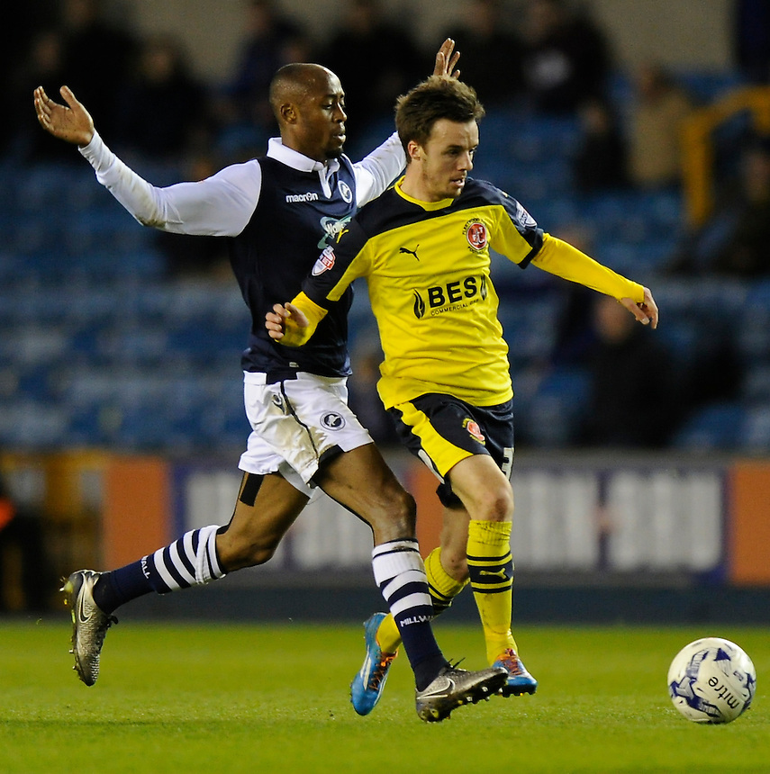 Fleetwood Town's Stefan Scougall holds off the challenge from Millwall's Nadjim Abdou<br /> <br /> Photographer Ashley Western/CameraSport<br /> <br /> Football - The Football League Sky Bet League One - Millwall v Fleetwood Town - Tuesday 19th April 2016 - The Den - London   <br /> <br /> &copy; CameraSport - 43 Linden Ave. Countesthorpe. Leicester. England. LE8 5PG - Tel: +44 (0) 116 277 4147 - admin@camerasport.com - www.camerasport.com