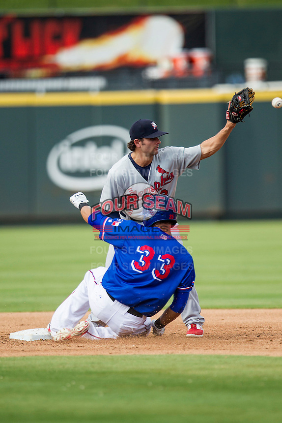 Memphis Redbirds shortstop Pete Kozma (8) waits for a throw to arrive as Round Rock Express base runner Carlos Pena (33) slides safely into second base during the first game of a Pacific Coast League doubleheader on August 3, 2014 at the Dell Diamond in Round Rock, Texas. The Redbirds defeated the Express 4-0. (Andrew Woolley/Four Seam Images)