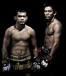 """Muay Thai Kickboxing figthers pose at Sangmorakot gymnasium in Bangkok, Thailand. Muay Thai, also know as """"Art of Eight Limbs"""", is a hard martial art and Thailand's national sport. Photo by Victor Fraile --- Image by © Victor Fraile"""