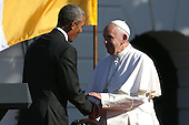 U.S. President Barack Obama (L) shakes hands with Pope Francis (R) during the arrival ceremony at the White House on September 23, 2015 in Washington, DC. The Pope begins his first trip to the United States at the White House followed by a visit to St. Matthew's Cathedral, and will then hold a Mass on the grounds of the Basilica of the National Shrine of the Immaculate Conception.<br /> Credit: Win McNamee / Pool via CNP