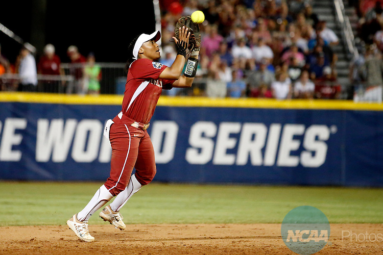 07 JUNE 2016:  Oklahoma infielder Kelsey Arnold (3) catches the ball during the Division I Women's Softball Championship is held at ASA Hall of Fame Stadium in Oklahoma City, OK.  Shane Bevel/NCAA Photos