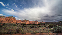 A large rainstorm passes through Cathedral Valley at Capitol Reef National Park, Utah