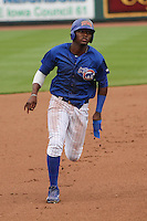 Iowa Cubs outfielder Junior Lake (21) heads towards third during a Pacific Coast League game against the Colorado Springs Sky Sox on May 10th, 2015 at Principal Park in Des Moines, Iowa.  Iowa defeated Colorado Springs 14-2.  (Brad Krause/Four Seam Images)