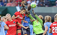 Portland, Oregon - Saturday July 2, 2016: Sky Blue FC goalkeeper Caroline Casey (27) punches the ball away from Portland Thorns FC forward Nadia Nadim (9) during a regular season National Women's Soccer League (NWSL) match at Providence Park.