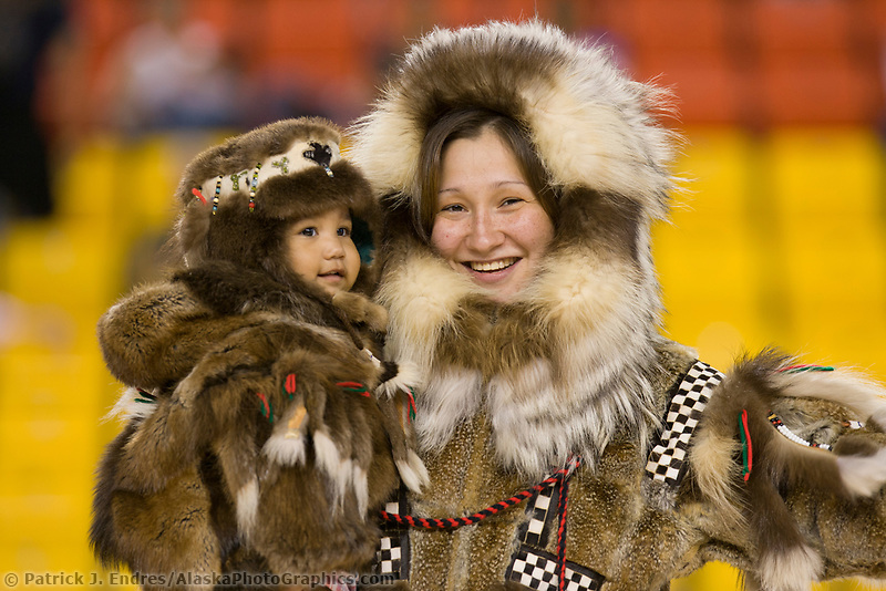 Carla Lapierre models a Yupik parka made of tundra squirrel with wolf ruff and calf skin patterns and beaver and wolf. Her daughter is wearing a beaver parka and hat. All made by her late grandmother Lucy Beaver of Bethel Alaska. 2007 World Eskimo Indian Olympics held in Anchorage, Alaska.